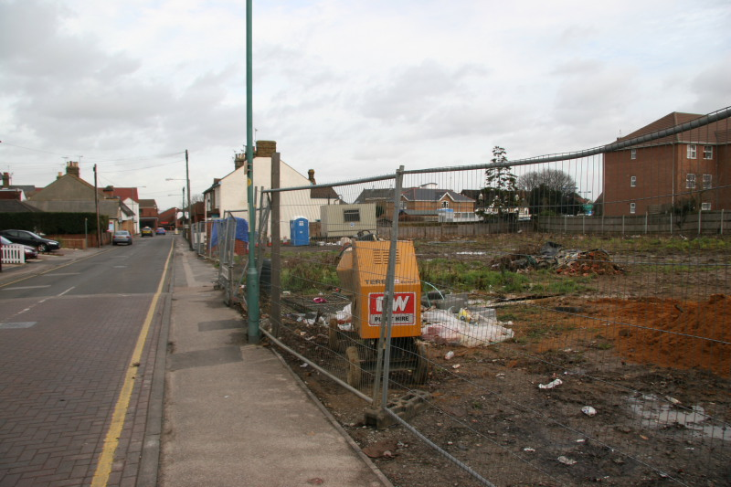 Looking towards Rainham with the cleared site after Lukehursts warehouse demolished showing view through to church and Millennium centr