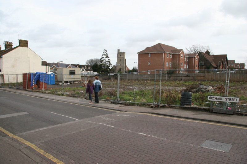 Site after Lukehursts warehouse demolished showing view through to church and Millennium centre